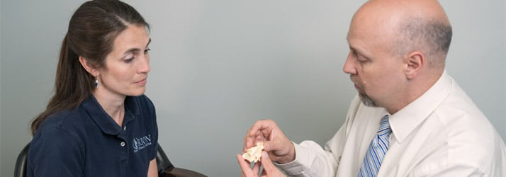 Chiropractor Lake Orion MI Christopher Bennett Educating Patient
